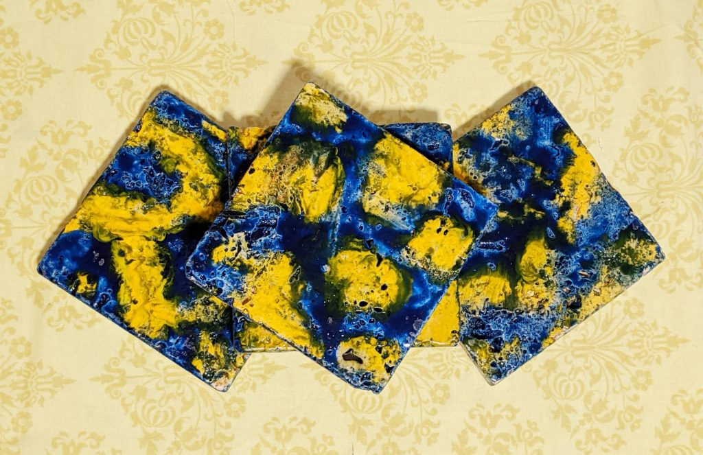 $12, Set of 4 Marbled Tile Coasters - Sealed with felt on bottom. Artist: April Bilow