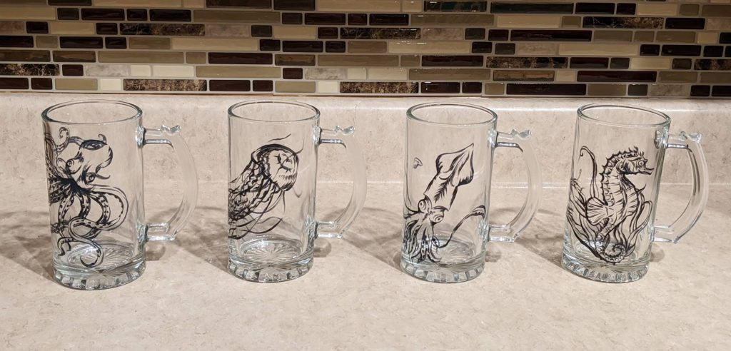 $35.00, Set of 4 Hand Painted Beer Glasses - Featuring an octopus, jellyfish, squid, and seahorse. Paint is cured and baked to a permanent finish - wash safe! Artist: Allise Noble